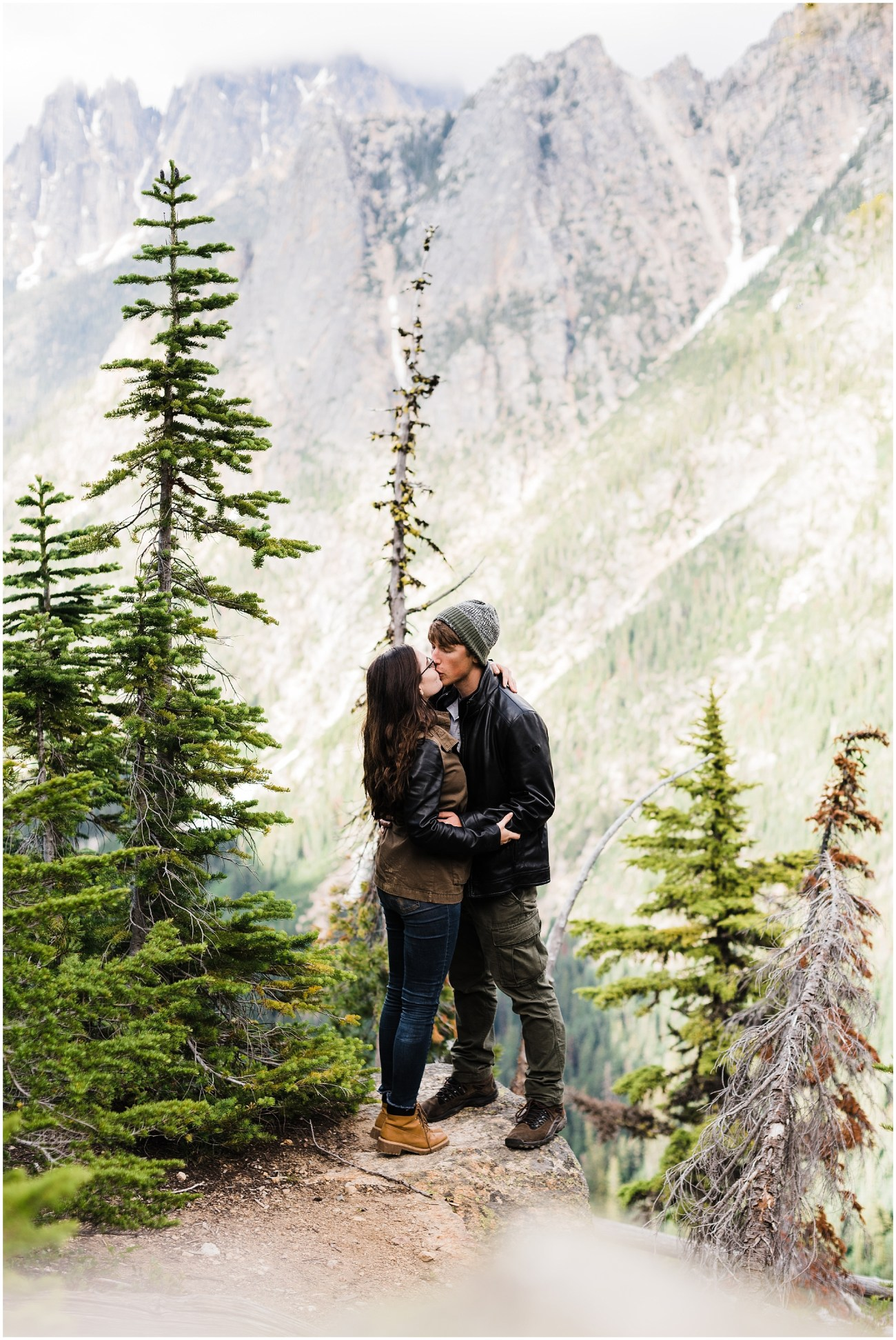 Photo of Laura & Devon on a ledge at the Washington Pass overlook in the North Cascades National Park