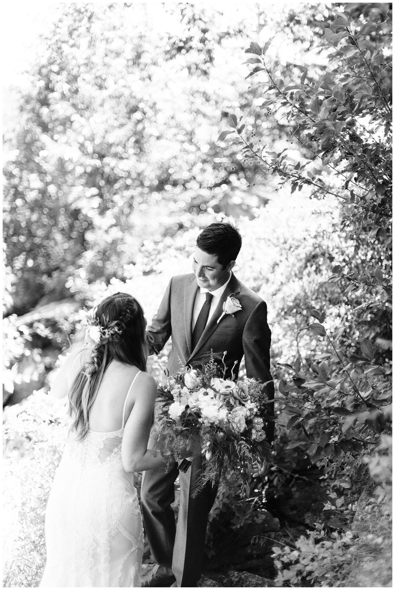 Black and White photo of a groom at his first look by Forthright Photo