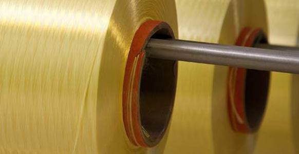 Material spools for kevlar blanket