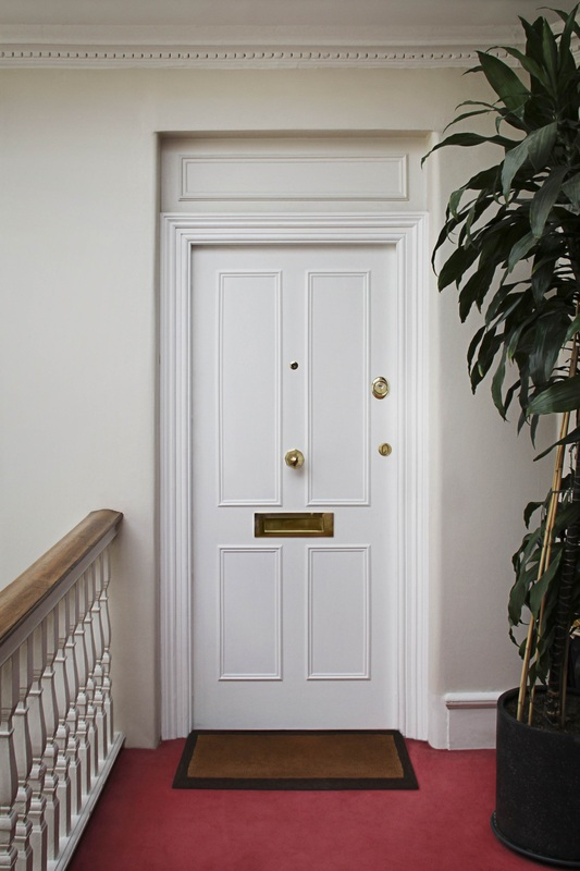 4-panel armored wood door in white paint