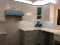 white shaker upper cabinets and grey shaker base cabinets ...