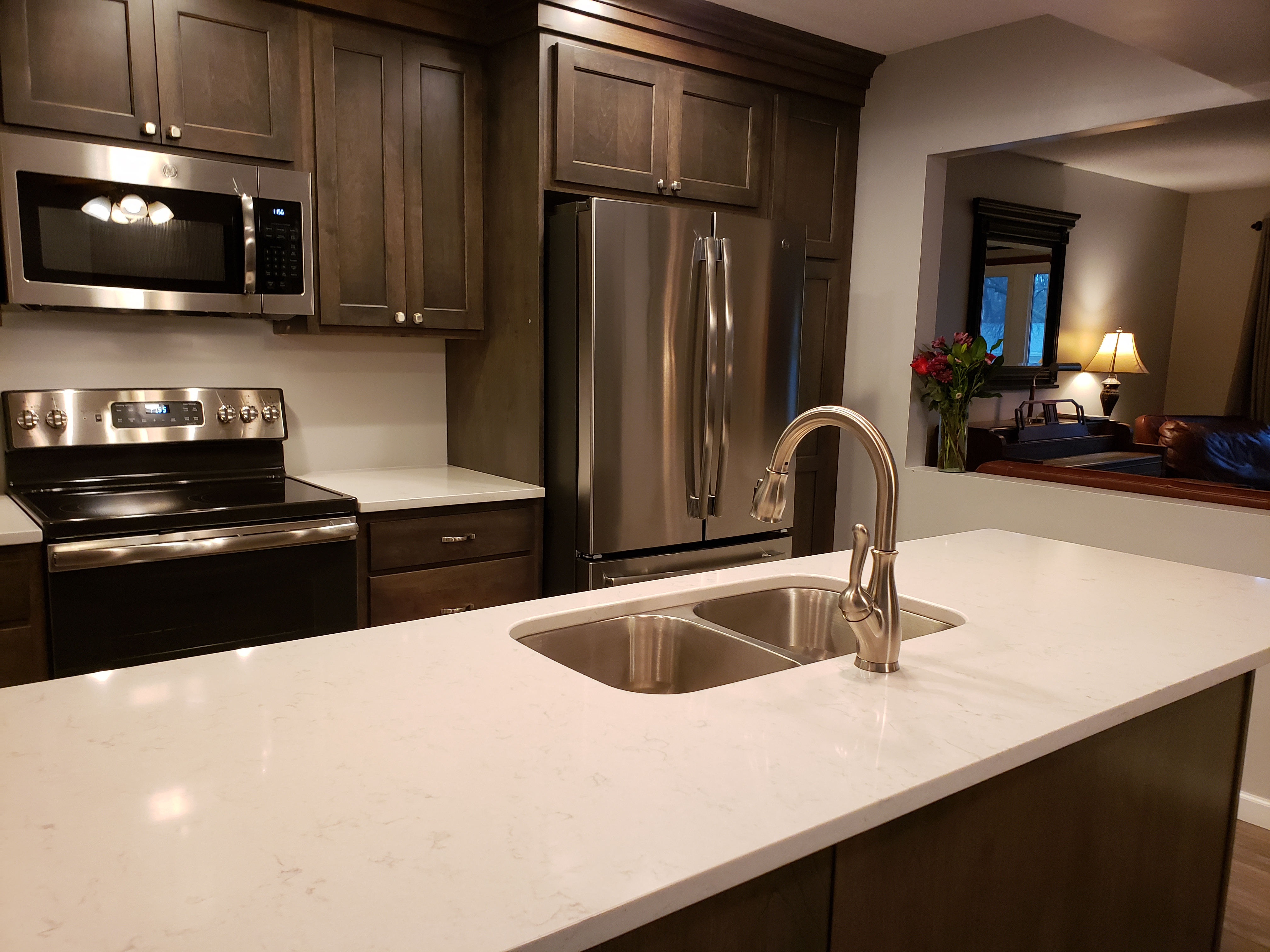 White countertop with dark cupboards