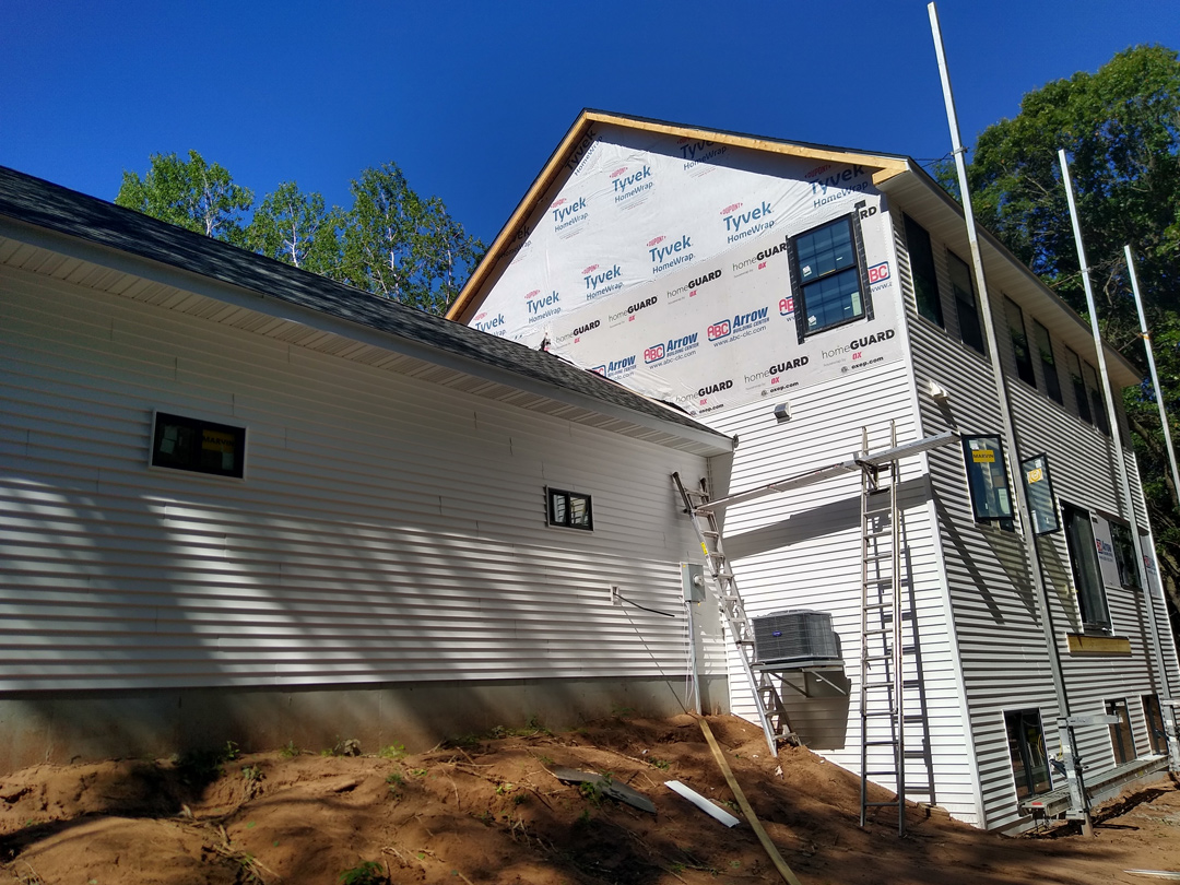 Back of house with siding being added