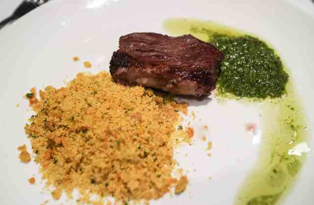 Signature beef rumpsteak with farofa and chimichurri at Pampa Brazilian Steakhouse, Calgary, Canada