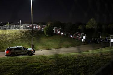 Officers guard the driveway into the jail while demonstrators gather at the Collin County Jail to demand justice for Marvin Scott III, who died while in custody at the jail on March 14, 2021.