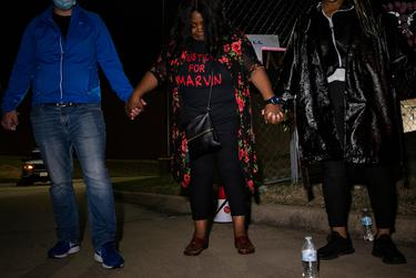 Marvin Scott III's mother, LaSandra Scott, prays at the end of a demonstration outside of the Collin County Jail. People gathered to demand justice for Marvin Scott III, who died while in custody at the jail on March 14, 2021.
