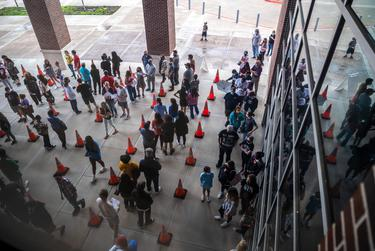 McKinney ISD students and their parents or legal guardians, wait for a COVID-19 vaccine at a site hosted by McKinney ISD and the McKinney Fire Department, on May 20, 2021.