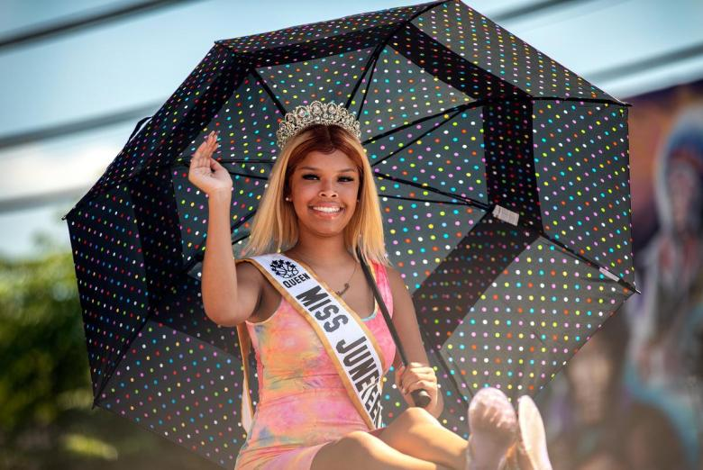 Kennedé Wallace, Austin's Miss Juneteenth waves to crowds during the annual Juneteenth parade in East Austin on June 19, 2021. Juneteenth commemorates Union Army General Gordon Granger's proclamation issued on June 19, 1865 in Galveston, which ordered the freedom of more than 250,000 enslaved Black people in Texas who were denied freedom for more than two years after President Abraham Lincoln signed the Emancipation Proclamation.