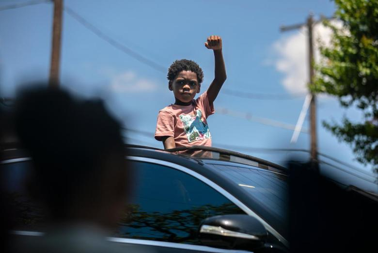 Austin residents celebrated during the annual Juneteenth parade in East Austin on June 19, 2021. Juneteenth commemorates Union Army General Gordon Granger's proclamation issued on June 19, 1865 in Galveston, which ordered the freedom of more than 250,000 enslaved Black people in Texas who were denied freedom for more than two years after President Abraham Lincoln signed the Emancipation Proclamation.
