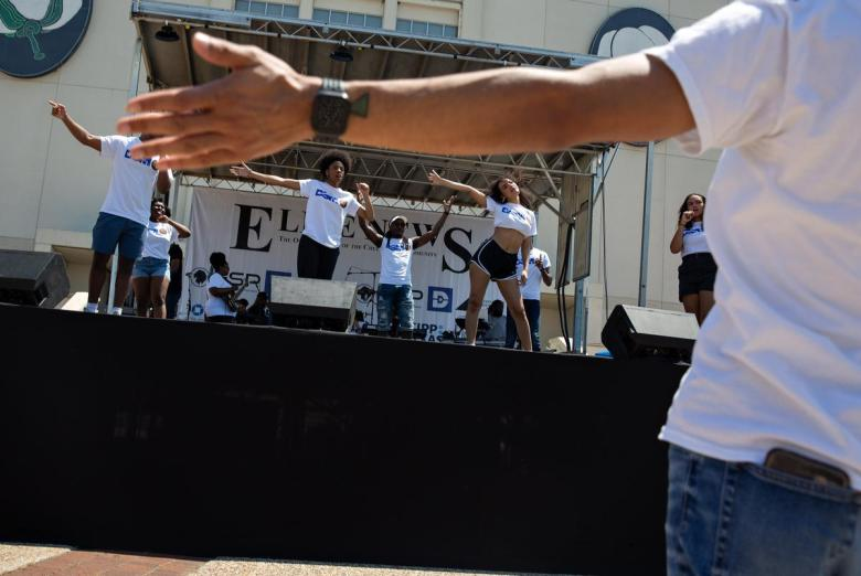 Dallas Summer Musicals director of education and community partnerships Devon Miller leads the group in a run through performance during the Juneteenth Festival at Fair Park in Dallas on June 19, 2021.