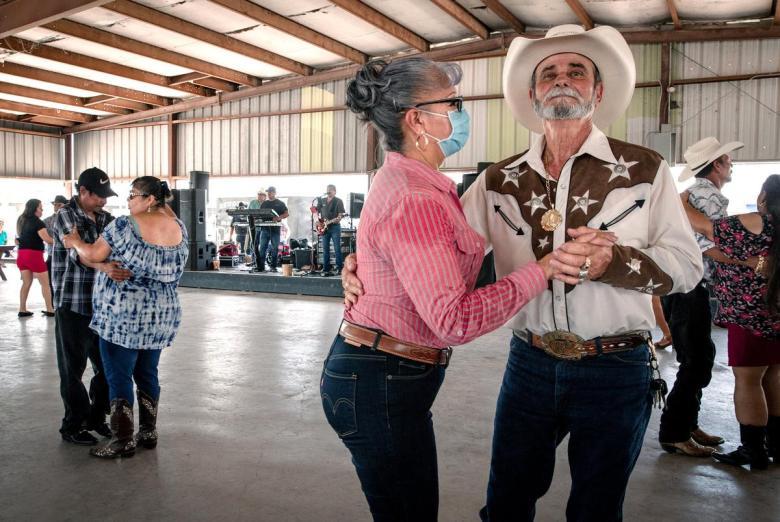 Rene Gonzales dances with his partner at the Mercedes Flea Market on June 13, 2021.