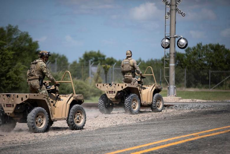 Texas Department of Public Safety officers ride all-terrain vehicles near a train depot in Spofford on Aug. 25, 2021. The officers were patrolling the area for migrants.