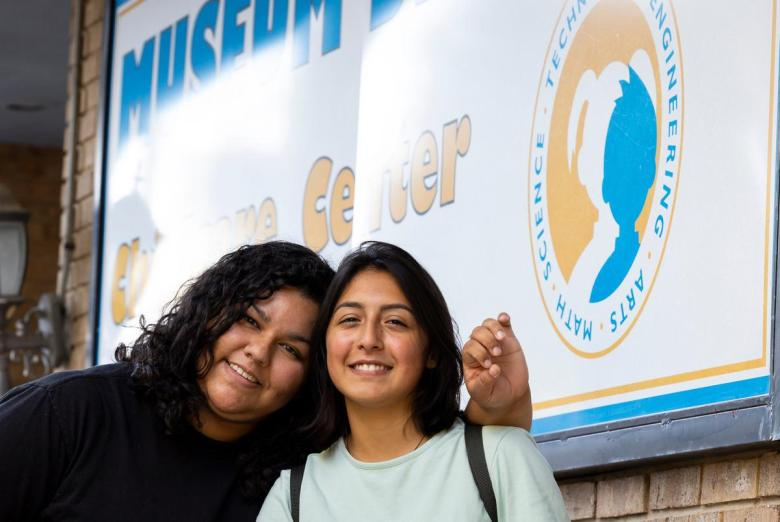 Museum District Childcare Center caregivers Issa Arevalo and Mishelle Acosta take off their masks after hours for a quick photo at the center on Monday, Aug. 30, 2021. Both women decided to get vaccinated - Arevalo after the loss of a dear friend and Acosta after listening to a parent who is also a doctor - in order to continue working at the center.