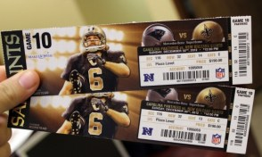 A photo of two tickets to a Saints game