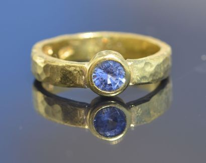 sapphire in forged band