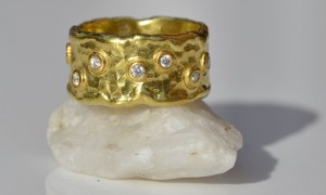 Wide forged ring with melted edge and bezel set scattered diamonds