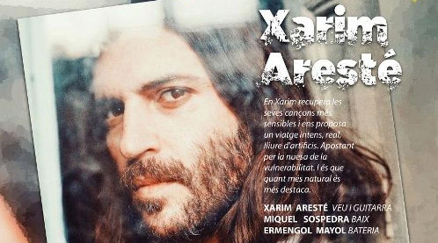 Part del cartell anunciant l'actuació de Xarim Aresté a la Seu d'Urgell