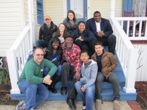 Belmont staff and students smile with Dr. John Perkins during their Immersion trip to Jackson, Miss.