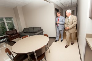 Belmont President Bob Fisher and Nashville Mayor Karl Dean tour an apartment in Two Oaks Hall, which will house 418 students.