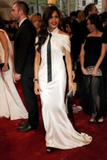 Freida Pinto, in Chanel Haute Couture, with a Chanel clutch.