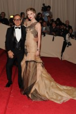 Gilles Mendel, with Taylor Swift, in J. Mendel, with Lorraine Schwartz jewels and Christian Louboutin shoes.