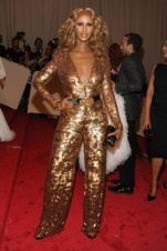 Iman, in Stella McCartney, with Fred Leighton jewels and a Kotur clutch.