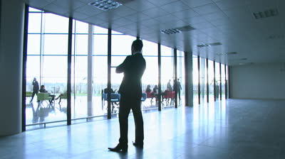 stock-footage-business-group-take-a-look-around-potential-new-office-space-high-quality-hd-video-footage