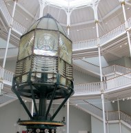 This huge lighthouse lamp towers over visitors in the Grand Gallery.