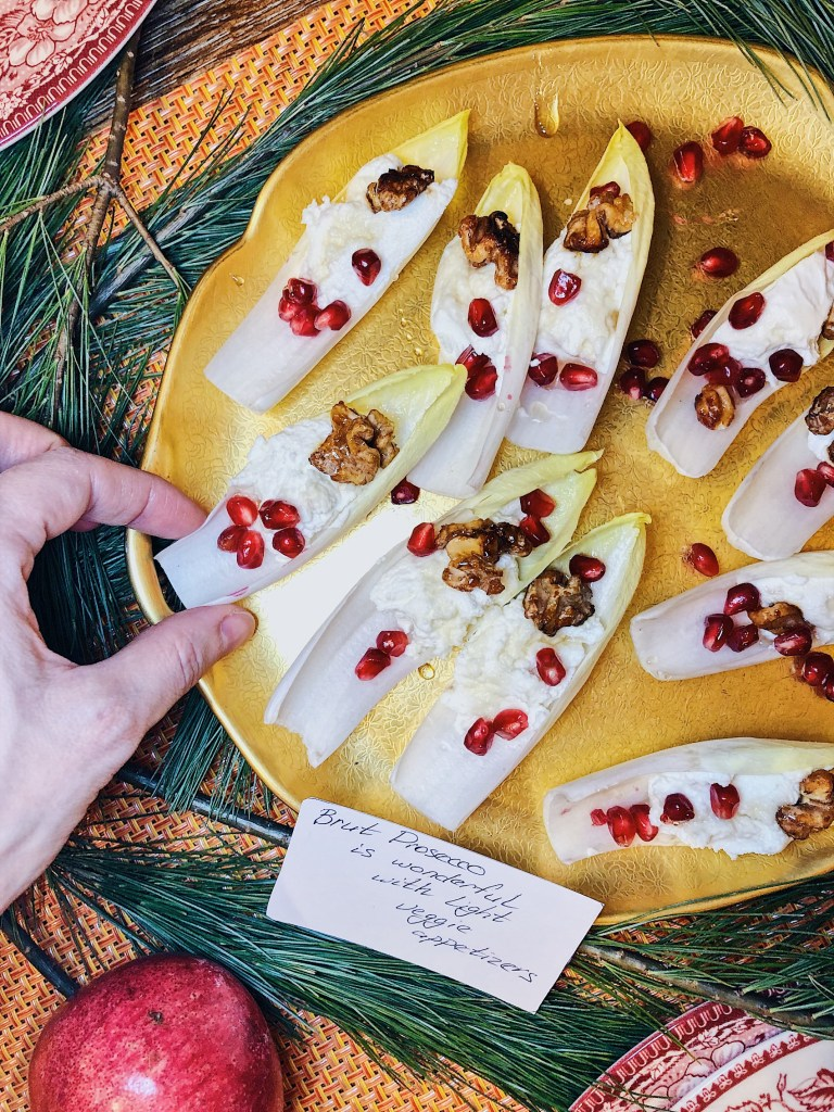Endive leaves stuffed with goat cheese and candied walnuts. Brut Prosecco is wonderful with light veggie appetizers.