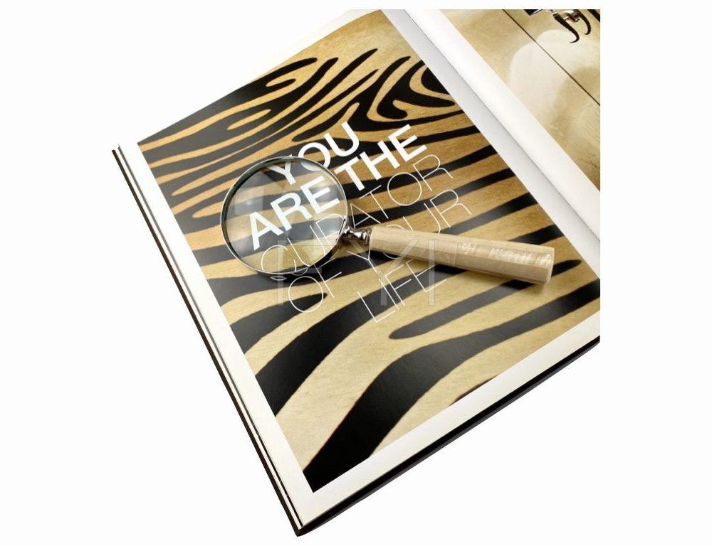 Vergrootglas Digo op Eric Kuster boek