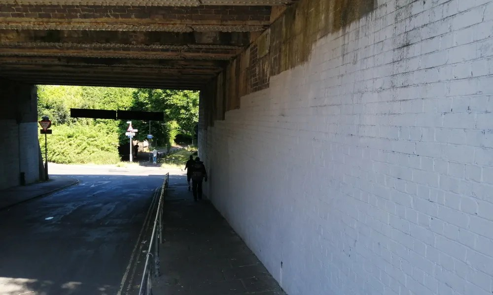 View under Windmill Hill railway bridge. This path forms the access from Bedminster Station to East Street and the area to the north of the railway line