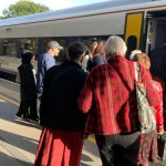 Passengers boarding a South Western Railway Bristol to Waterloo service at Bath Spa