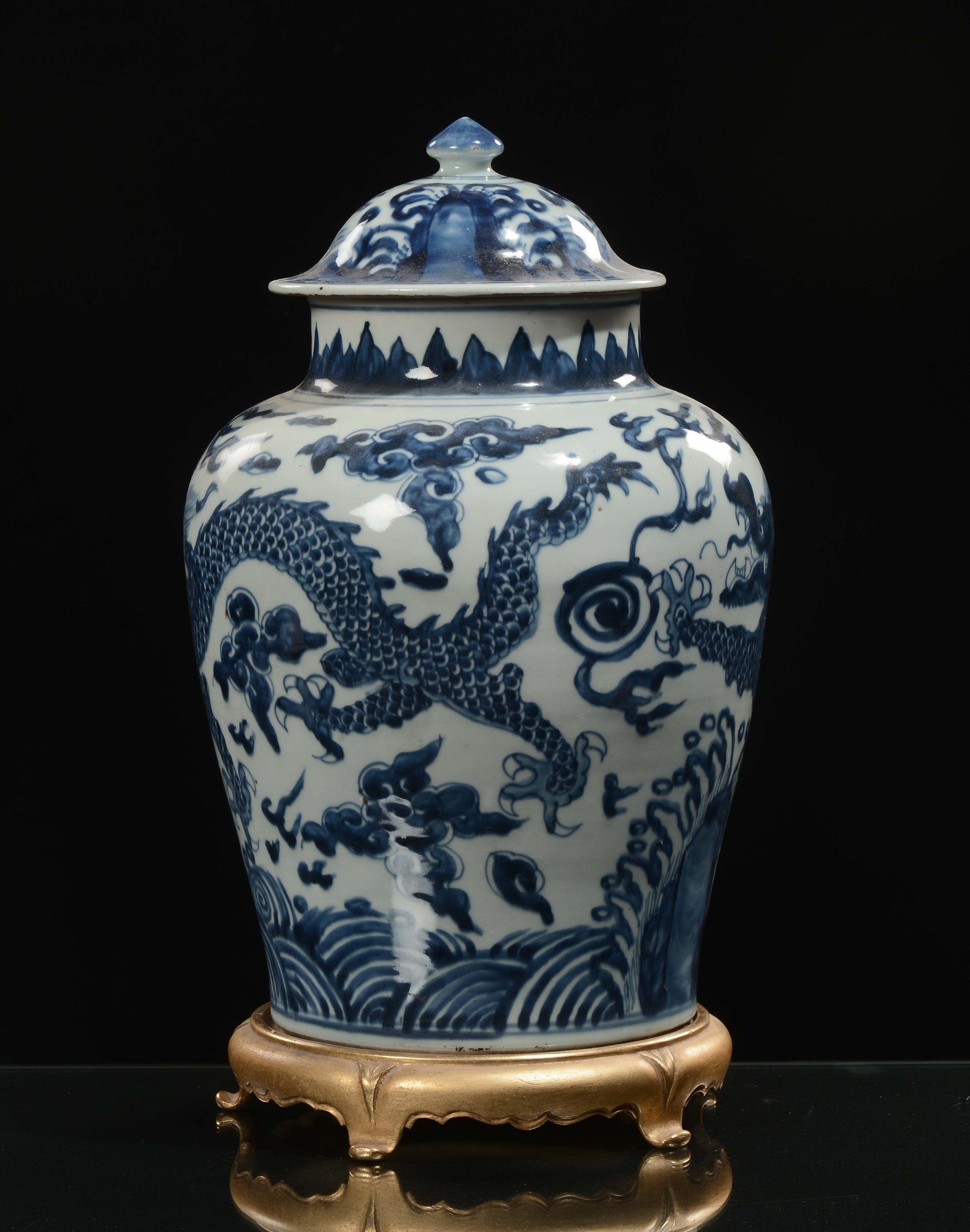 A white and blue porcelain vase with cover depicting