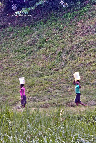 These two ladies living near to Source of Nile River. But they must walk for many distances to bring the water at home.