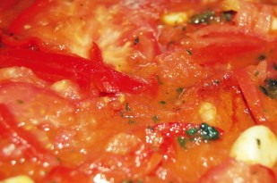 tomatoes melting to make sauce