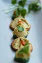 peri peri hummus on cucumber bites