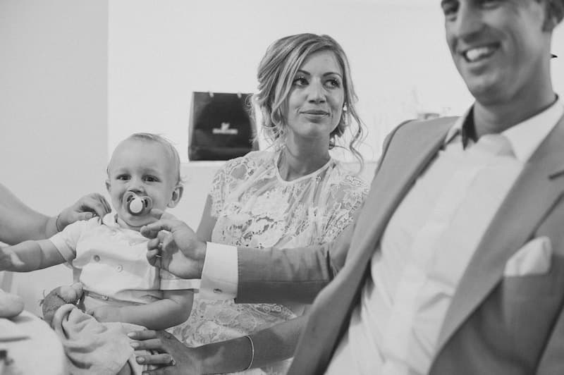 bride holding baby during speech