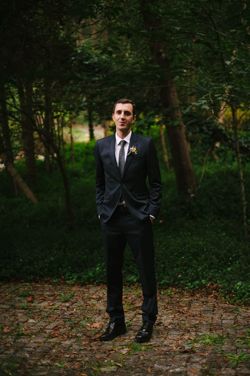 portrait of groom against forest background