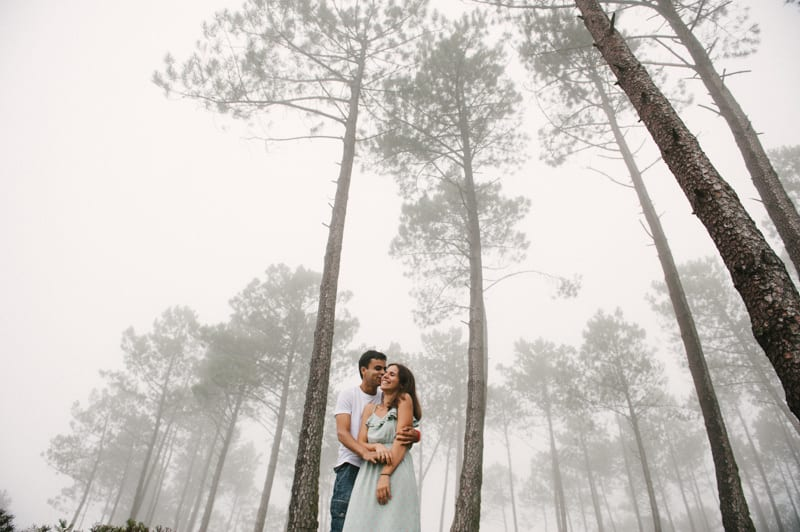 Couple with tall trees
