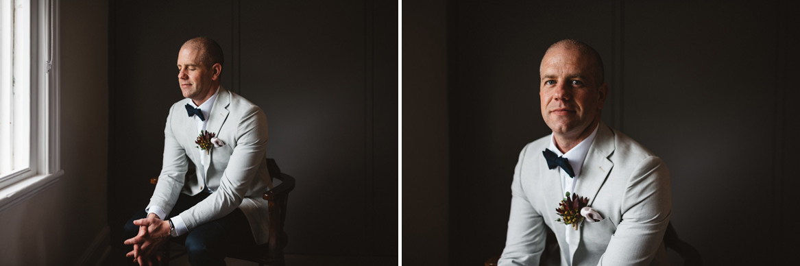 tasmania wedding photographer portrait of groom in a white jacket