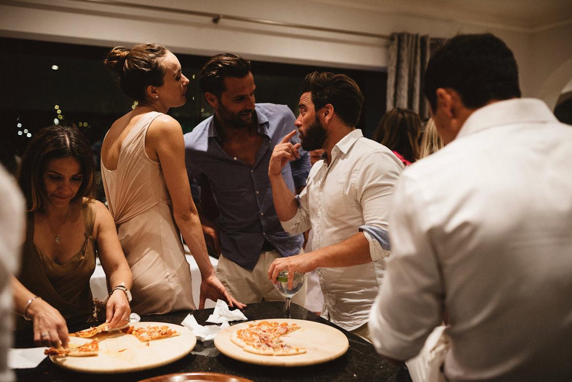 guests having late night pizza during wedding at casa rupi
