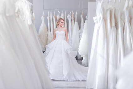 Beautiful woman in a white dress in wedding shop