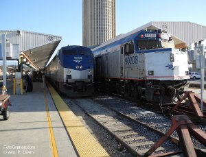 Amtrak's Southwest Chief rest on arrival in Los Angeles. On the right a commuter train waits to shove out. The Los Angles County jail rises in the background. © William P. Diven