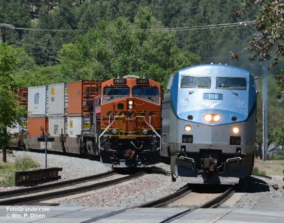 The Southwest Chief pulling into Flagstaff 7+ hours late passes a stopped freight train. Photo © William P. Diven.