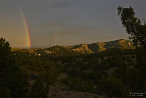 Monsoon rainbow behind the Sandia Mountains near Albuquerque, N.M. Photo © William P. Diven