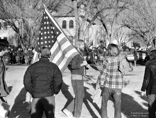 War protester Gary Werner marches in parallel with ROTC cadets. New Mexico State University, early 1970. Photo © William P. Diven.