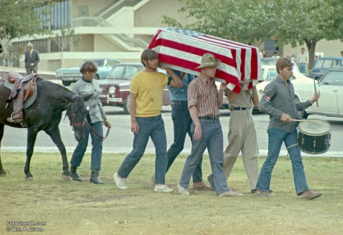 War protesters, one of them an Air Force ROTC cadet, mimic a funeral procession leading to a 1971 rally at New Mexico State University. Photo © William P. Diven.