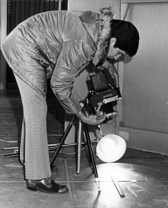 Forensic photographer with Speed Graphic 4x5 camera.
