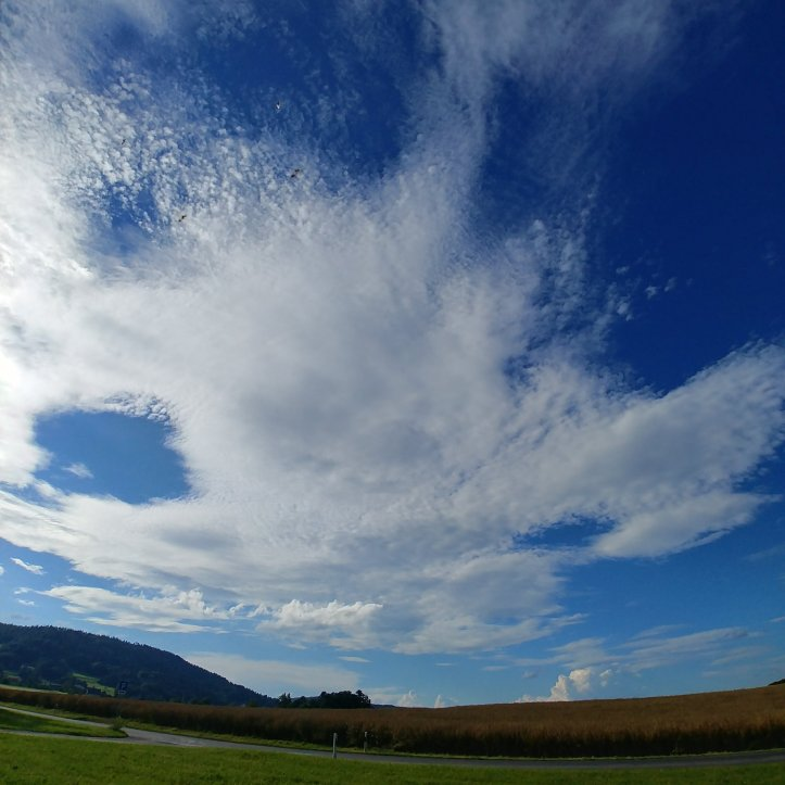 Pretty clouds in the blue sky, naturephotography by fotosbykarin