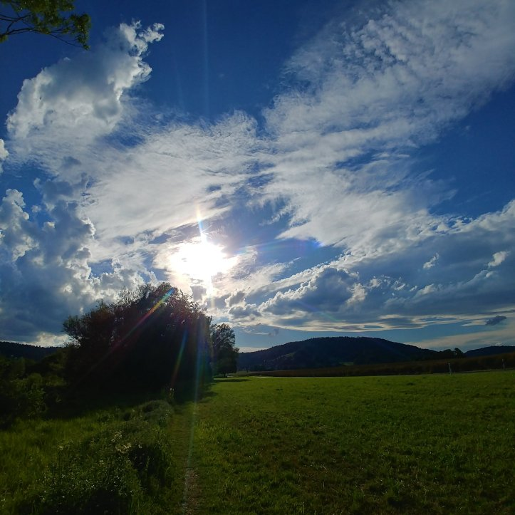 Clouds and sunshine, pretty landscape photo by fotosbykarin